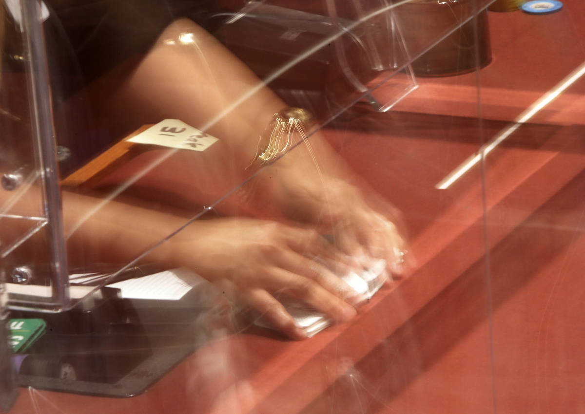 A dealer shuffles cards in $175 No-Limit Hold'em Ladies tournament during 2021 Nevada State Lad ...