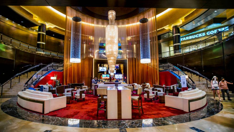 The Lobby Bar is the plush red-carpeted lounge nestled at the foot of two winding staircases, b ...
