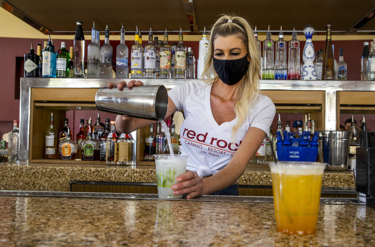 Bartender Tiffany Mann finishes off a cucumber mint cooler beside a spiked pog drink at the San ...
