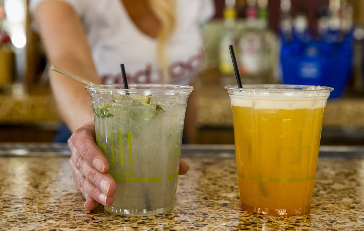 Bartender Tiffany Mann offers a cucumber mint cooler, left, beside a spiked pog drink at the Sa ...