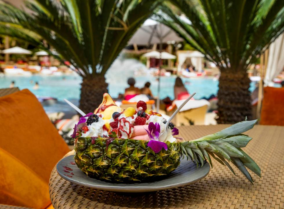 The Mega Dole Whip Sundae offered poolside has mango and strawberry Dole Whip, topped with frui ...