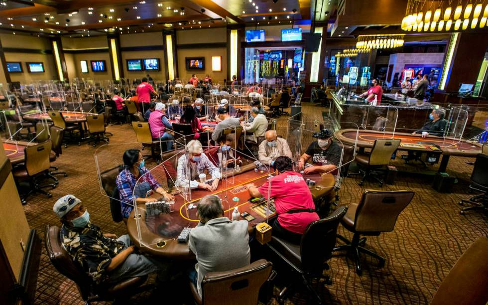 Players are separated by plexiglass during play in the poker room.( L.E. Baskow/Las Vegas Revie ...