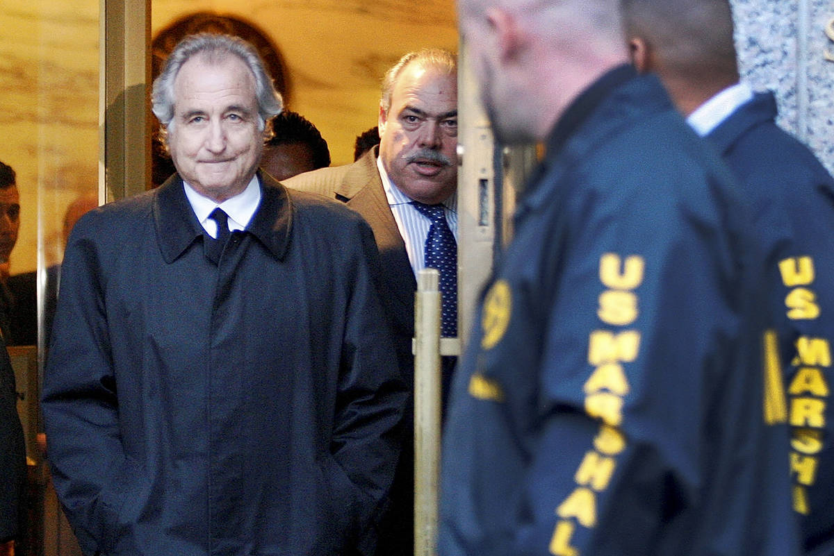 FILE - Disgraced financier Bernard Madoff leaves U.S. District Court in Manhattan after a bail ...