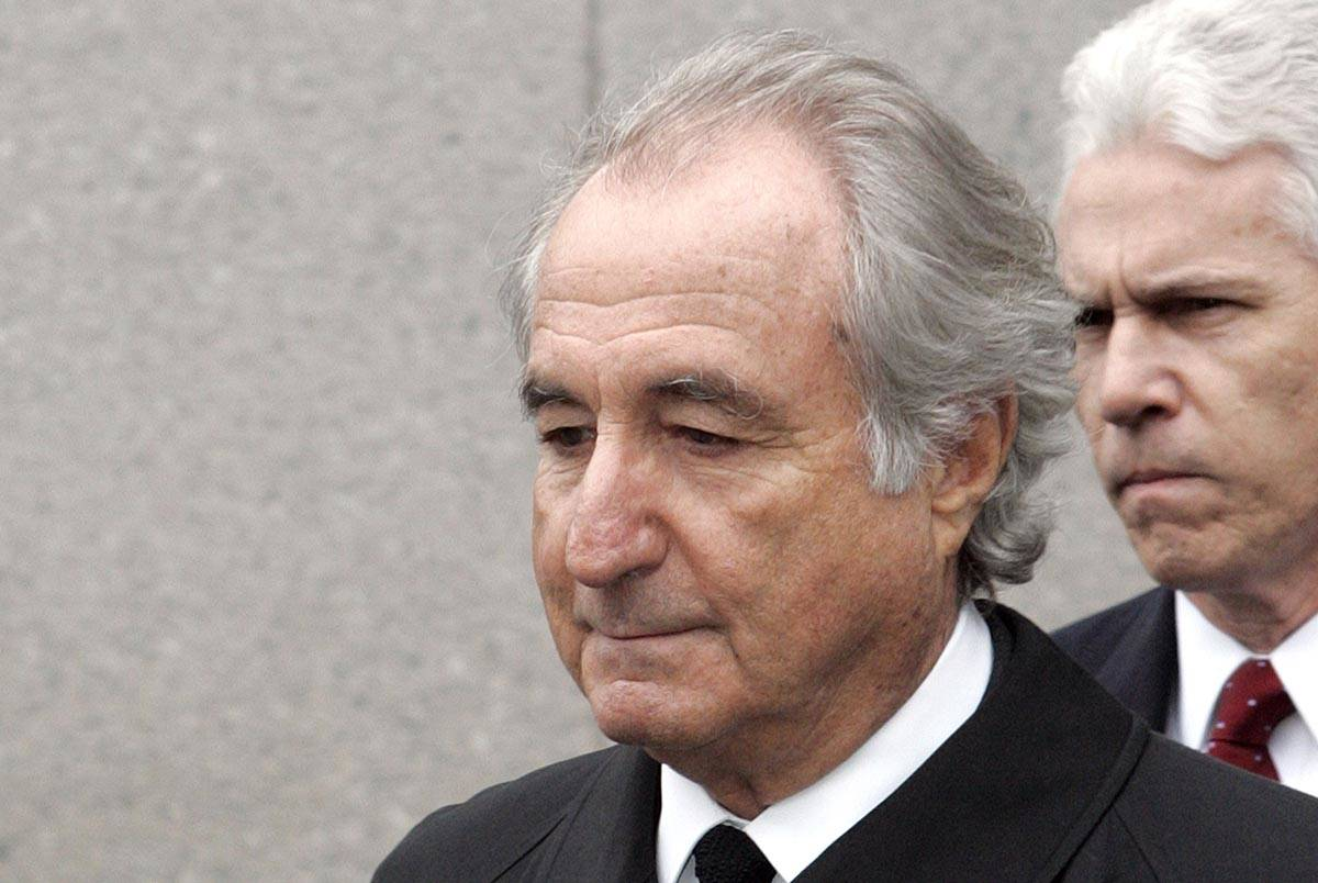 In this March 10, 2009, file photo, former financier Bernard Madoff exits Federal Court in New ...