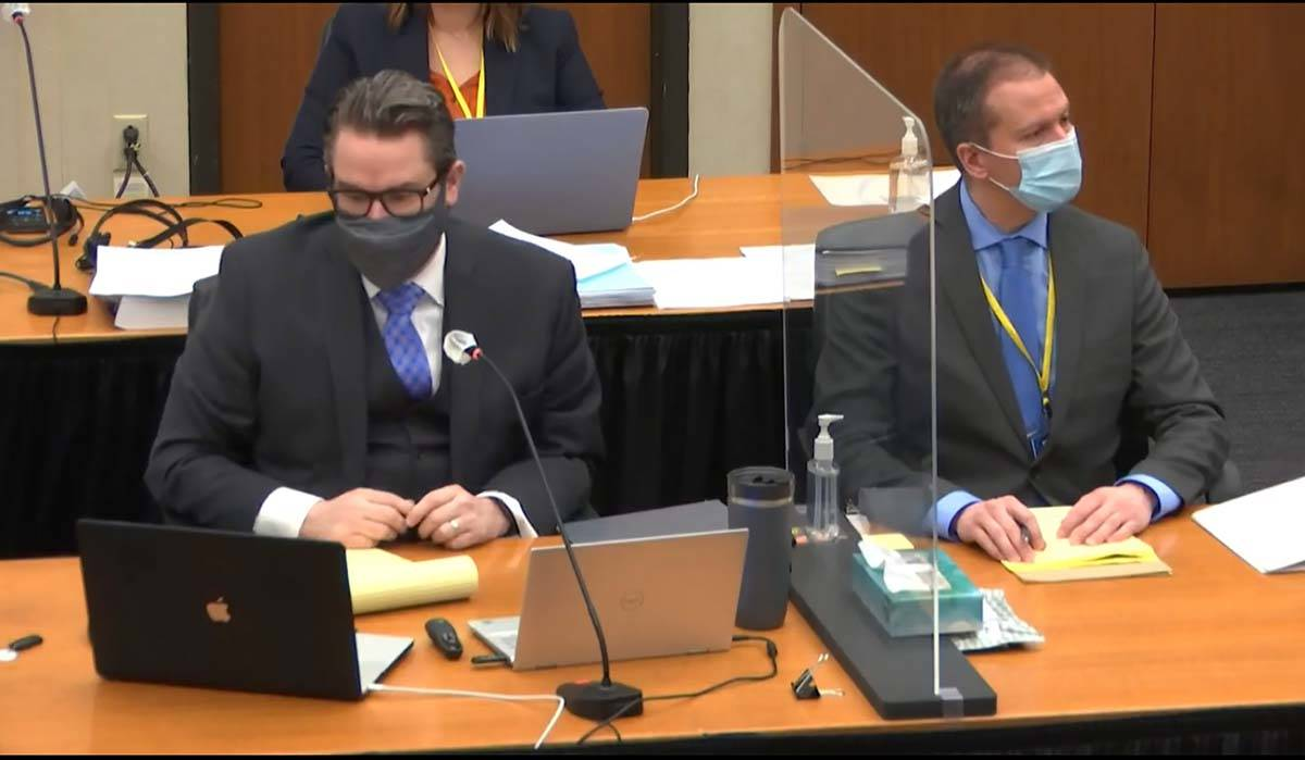 In this image from video, defense attorney Eric Nelson, left, defendant, former Minneapolis pol ...