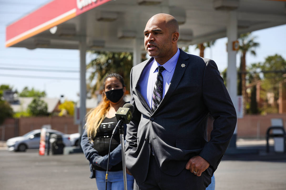 Jenifer Torres, left, wife of Kashif Brown, listens as Metropolitan Police Department homicide ...