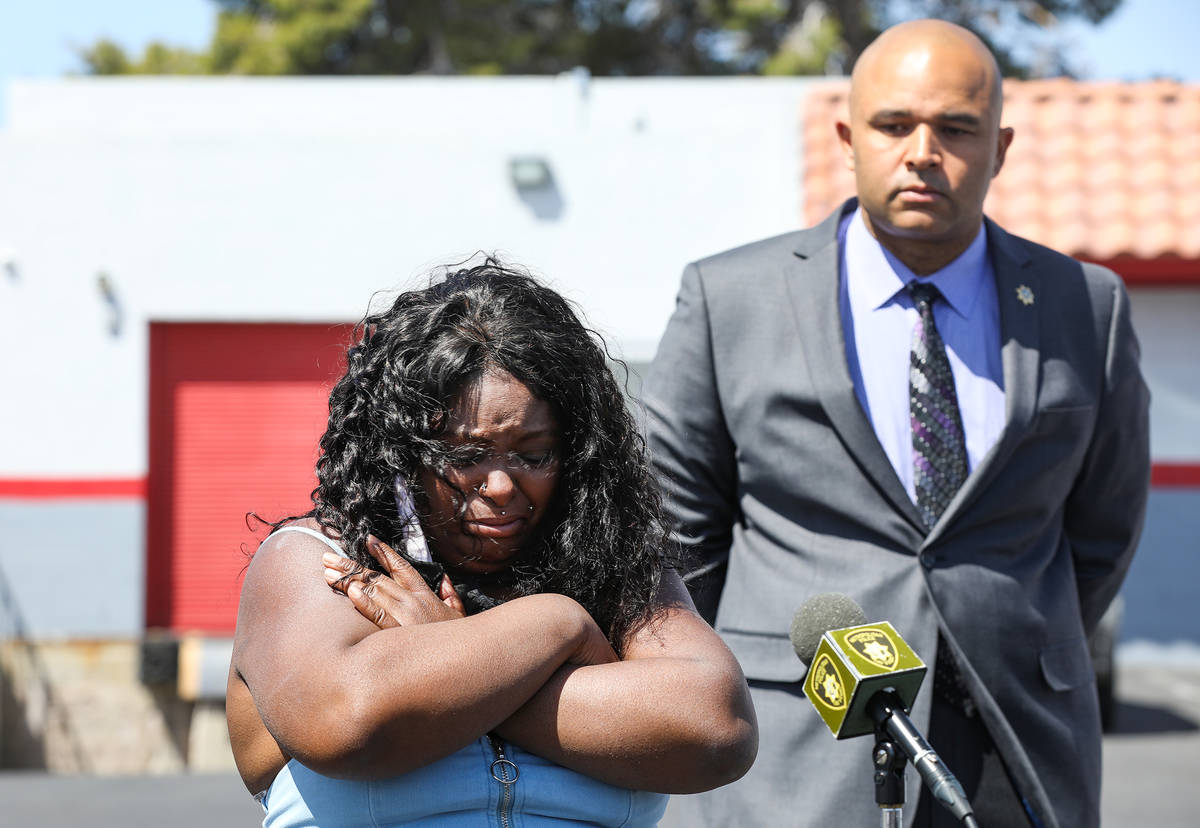 Maria Levi, mother of Kashif Brown, cries during a press conference as Metropolitan Police Depa ...