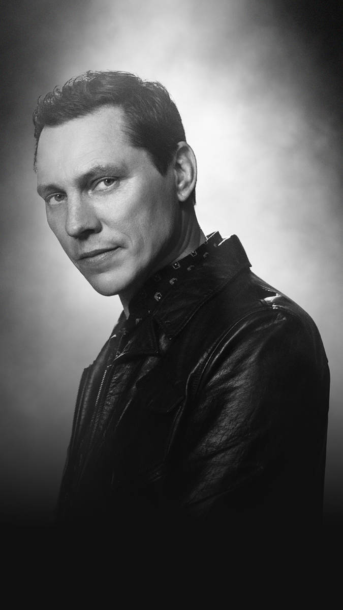 Tiësto is shown in a promotional shot for his upcoming residency at Zouk Nighclub and Ayu Dayc ...