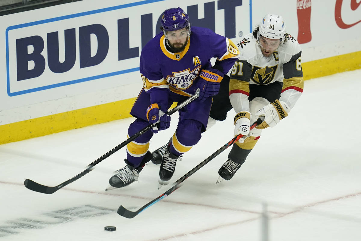 Los Angeles Kings defenseman Drew Doughty (8) and Vegas Golden Knights right wing Mark Stone (6 ...