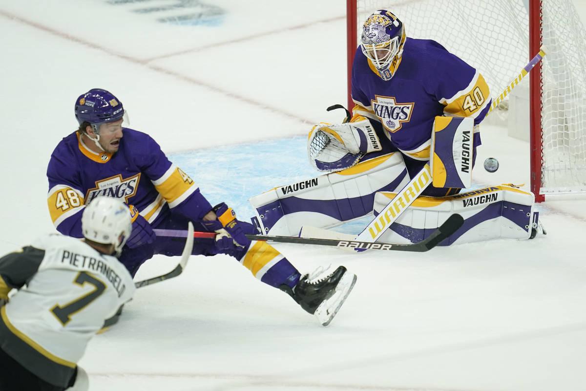Los Angeles Kings left wing Brendan Lemieux (48) and goaltender Calvin Petersen (40) block a sh ...