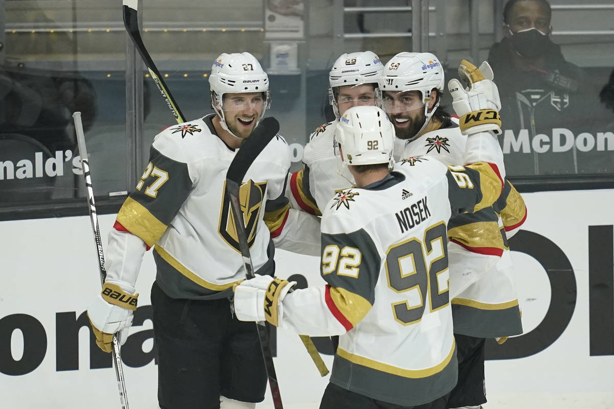 Vegas Golden Knights right wing Alex Tuch (89) celebrates with team mates after he scored a goa ...