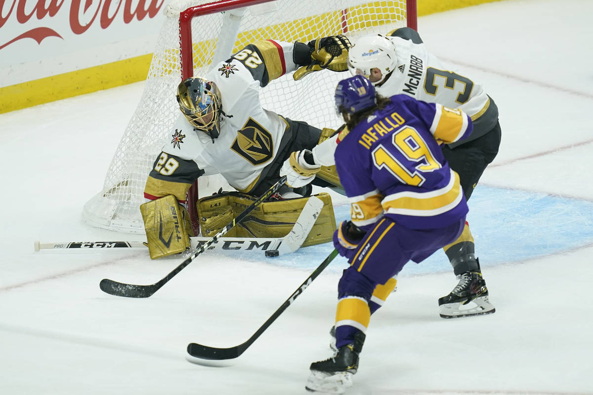 Vegas Golden Knights goaltender Marc-Andre Fleury (29) and defenseman Brayden McNabb block a sh ...