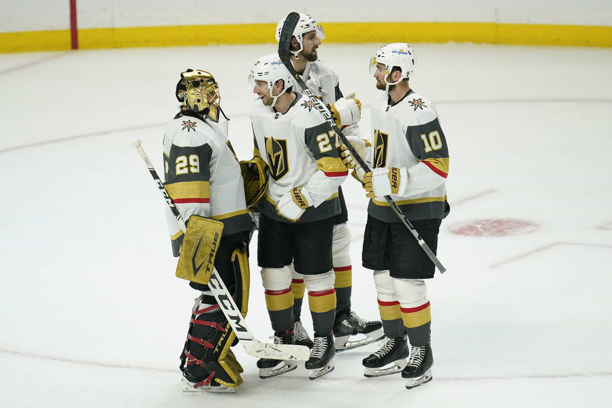 Vegas Golden Knights goaltender Marc-Andre Fleury (29), defenseman Shea Theodore (27), defensem ...