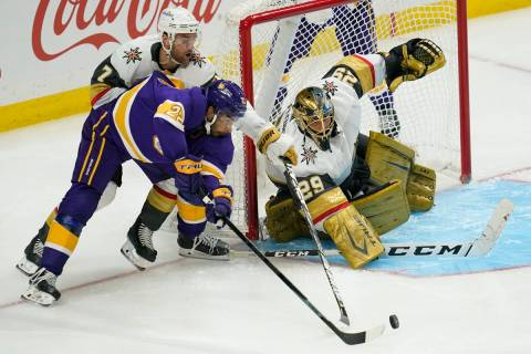 Los Angeles Kings left wing Andreas Athanasiou (22), defenseman Alex Pietrangelo (7) and goalte ...