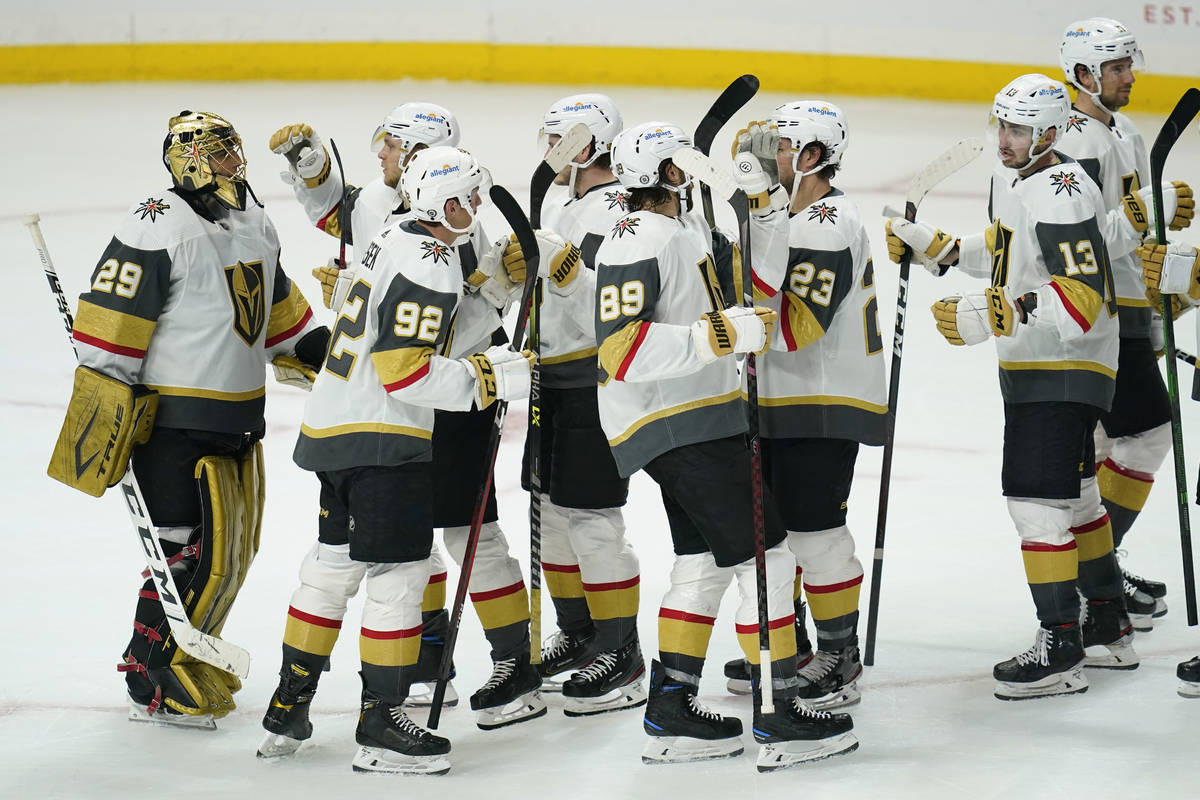 The Vegas Golden Knights celebrate a 6-2 win after their NHL hockey game against the Los Angele ...
