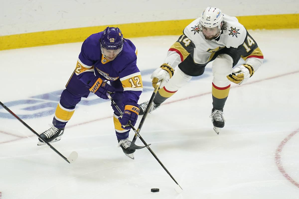 Los Angeles Kings center Trevor Moore (12) and Vegas Golden Knights defenseman Nicolas Hague (1 ...