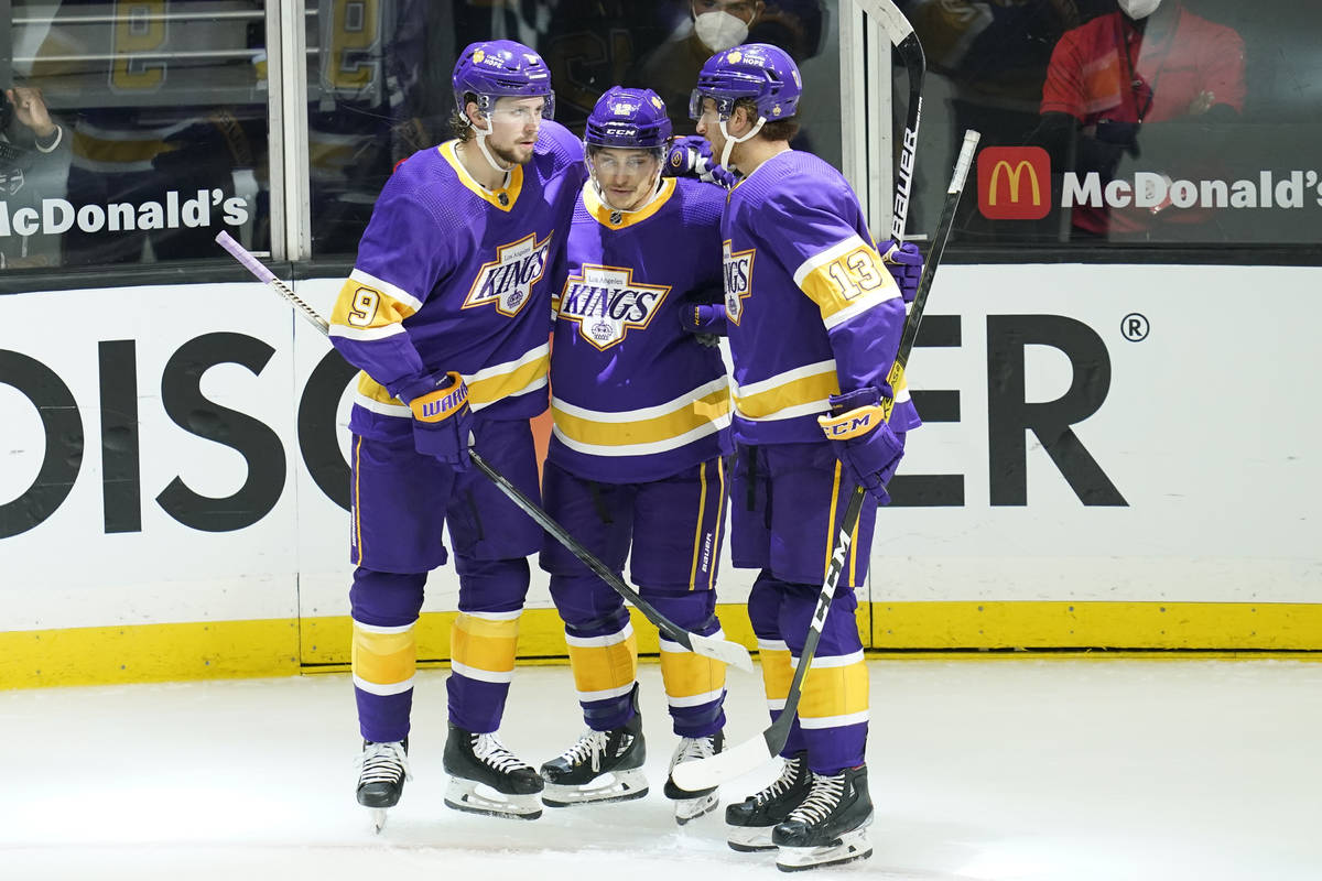 Los Angeles Kings center Trevor Moore (12) celebrates with right wing Adrian Kempe (9) and cent ...