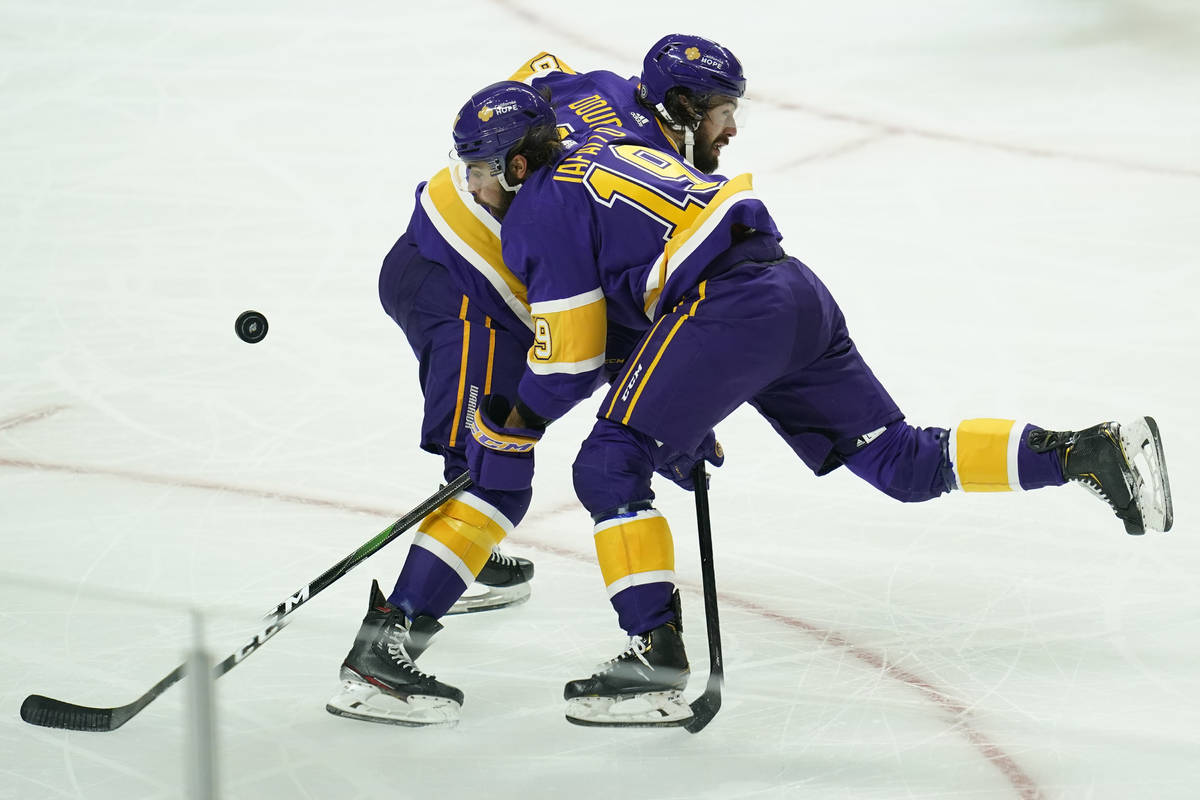 Los Angeles Kings defenseman Drew Doughty (8) and right wing Alex Iafallo (19) collide during t ...