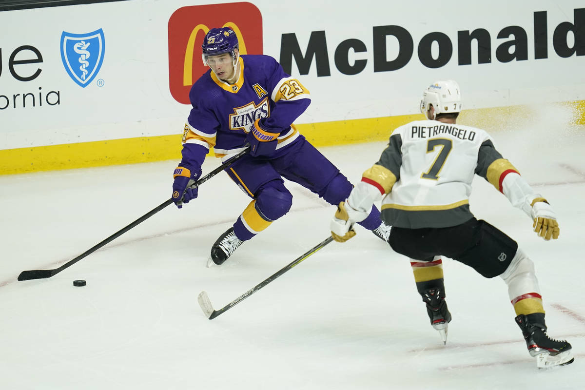 Los Angeles Kings right wing Dustin Brown (23) takes control of the puck from Vegas Golden Knig ...