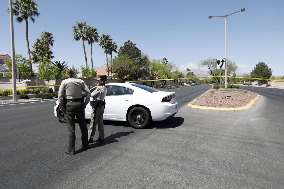 Police block a part of West Lake Mead Boulevard after a fatal car crash, Wednesday, April 14. 2 ...