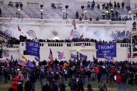 FILE - In this Wednesday, Jan. 6, 2021, file photo, violent rioters storm the Capitol, in Washi ...