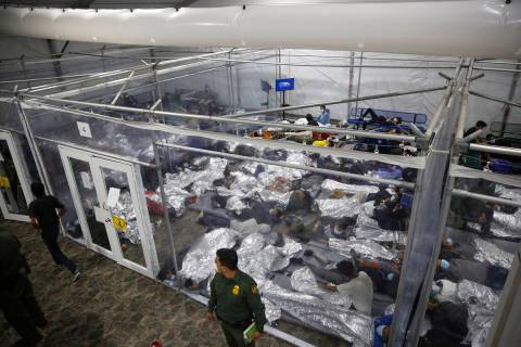 Minors are seen inside a pod at the Donna Department of Homeland Security holding facility in D ...