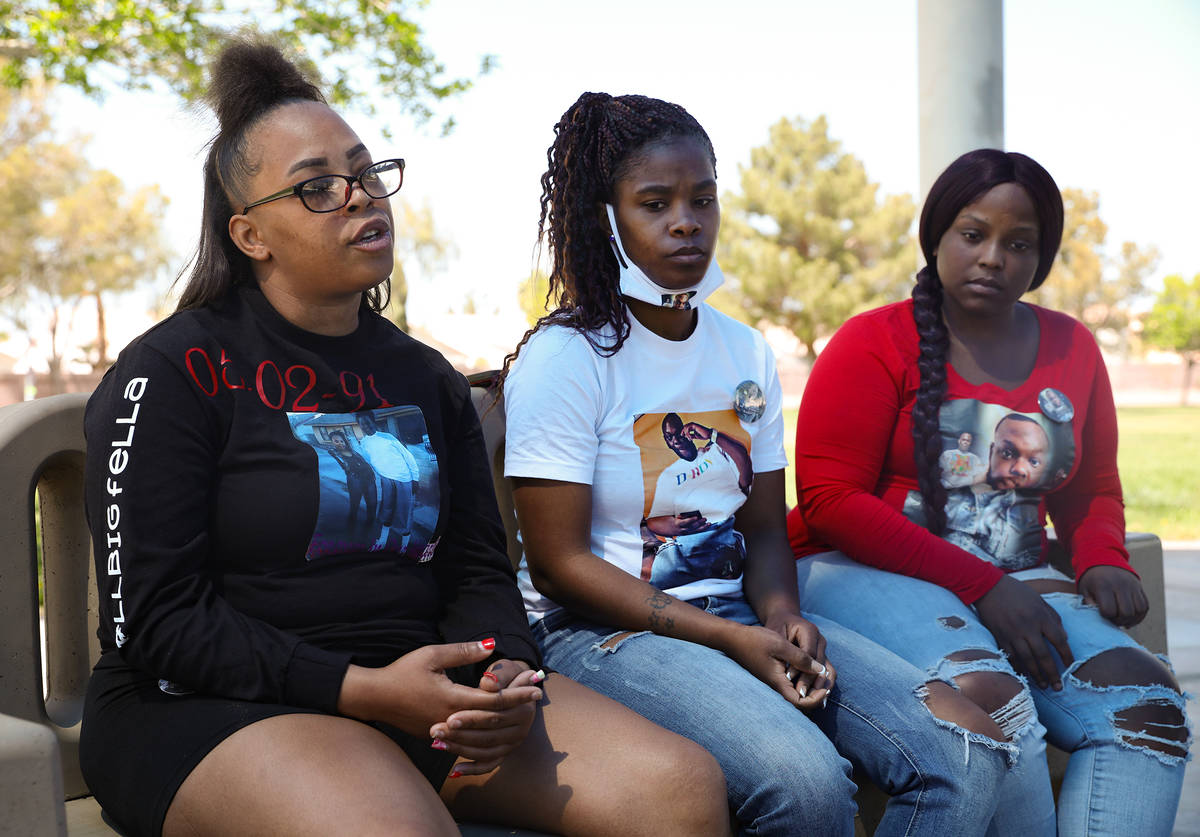 Wynesha Lewis, left, niece to Jaylon Tiffith, who was killed after he dropped off his daughter ...
