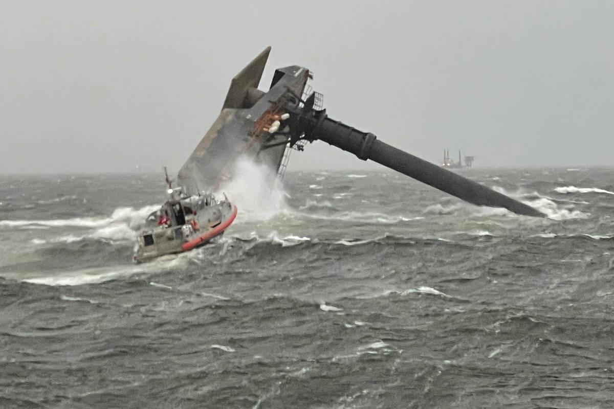 A Coast Guard Station Grand Isle 45-foot Respone Boat-Medium boatcrew heads toward a capsized 1 ...