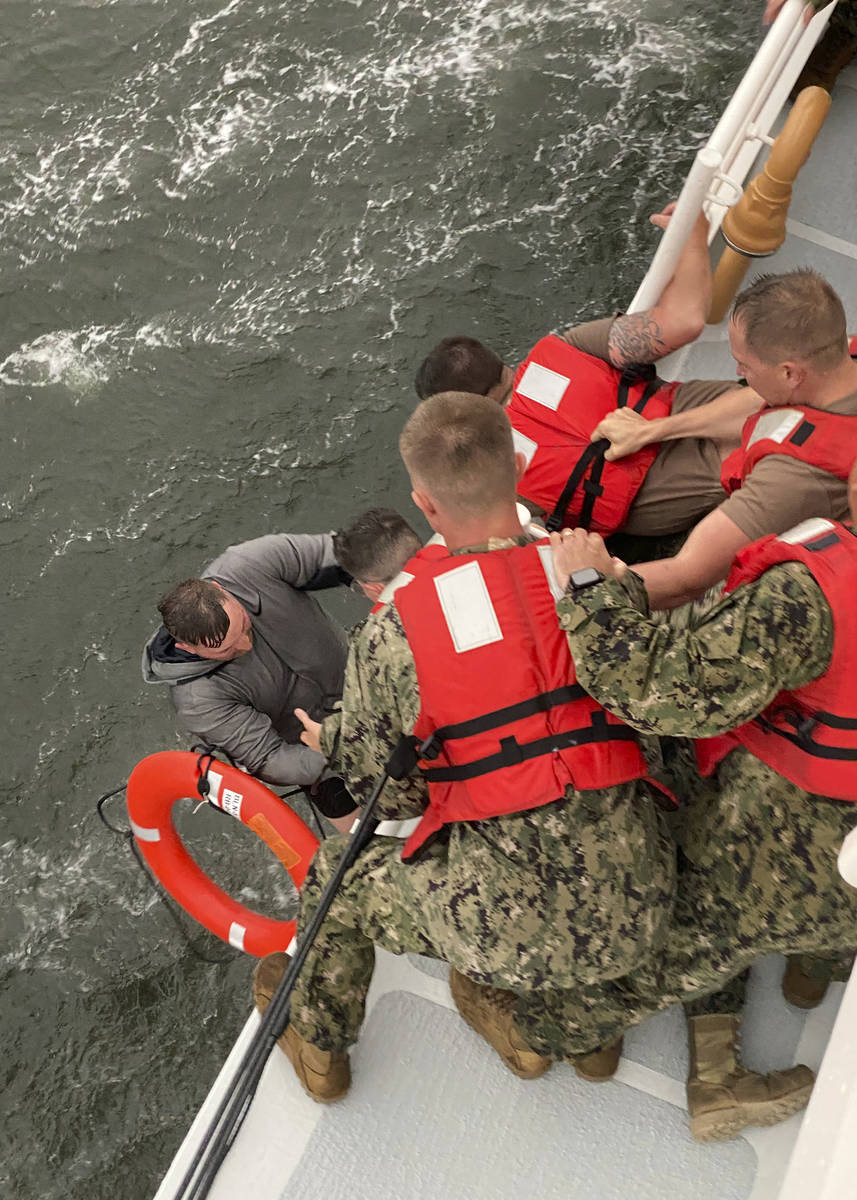 In this photo provided by the U.S. Coast Guard, crew members of the Coast Guard Cutter Glenn Ha ...