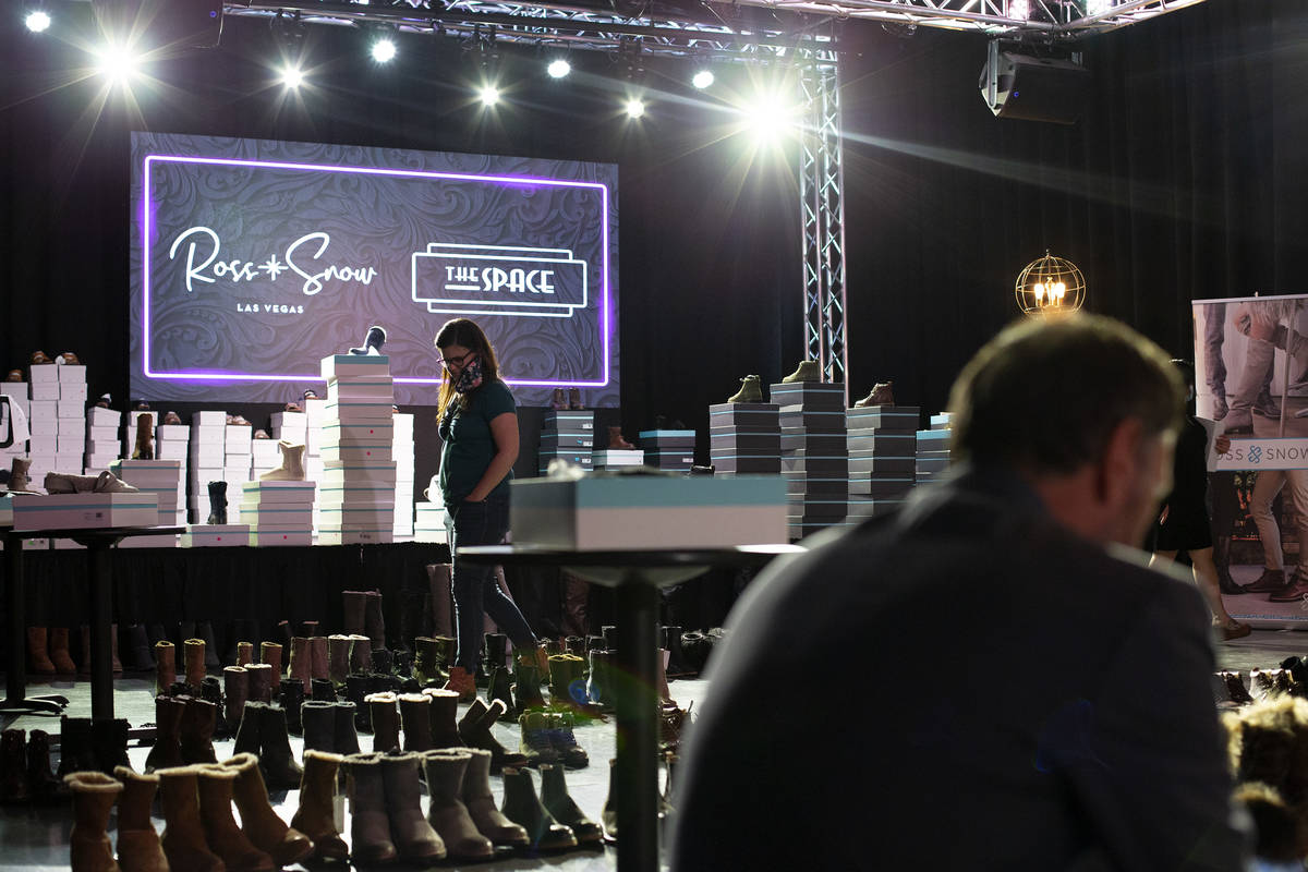 Shoppers browse at Vegas-based footwear brand Ross & Snow's pop-up sale at The Space on Wed ...
