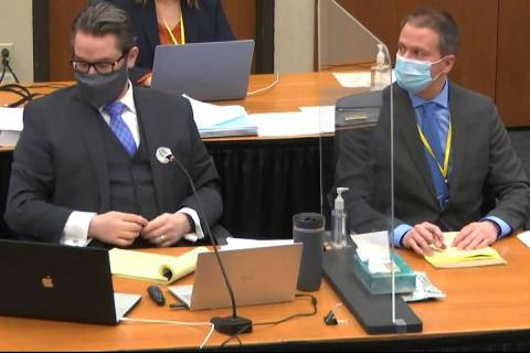 In this image from video, defense attorney Eric Nelson, left, and defendant, former Minneapolis ...