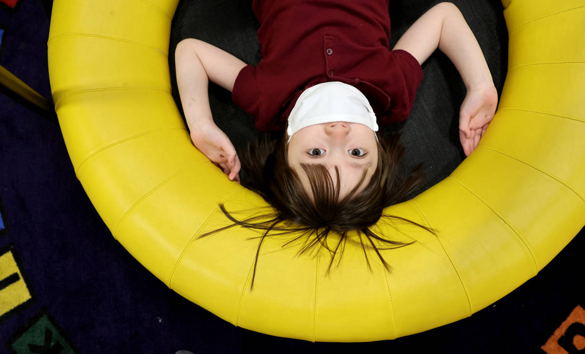 Akara Haase, 6, poses for a portrait in a learning and play area called The Park at the Center ...