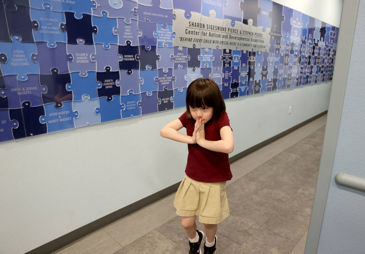 Akara Haase, 6, leaves after a session at the Center for Autism and Developmental Disabilities ...