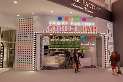 A rock wall made out of candy is one of the attractions at the goblet bar of the Sugar Factory ...