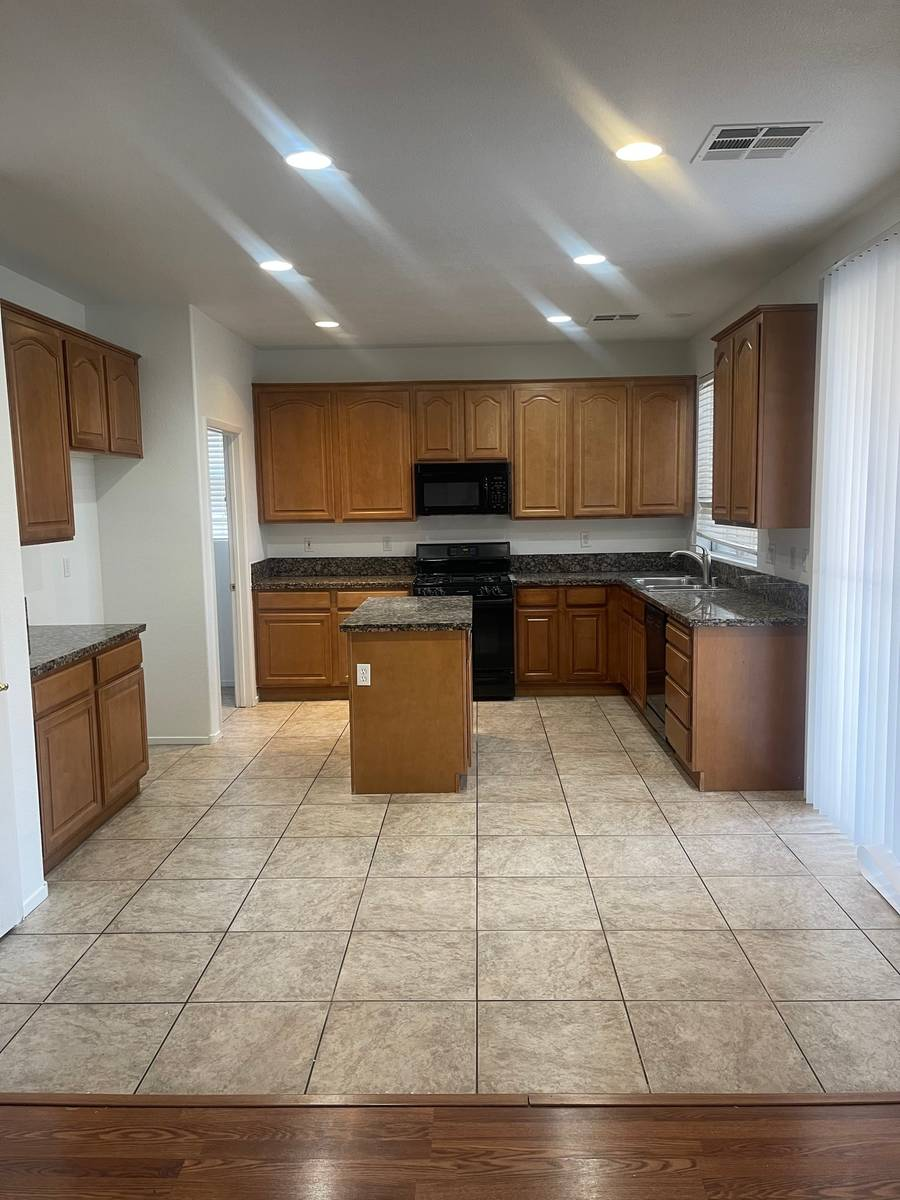 The kitchen of 5720 Deer Brush Court, North Las Vegas includes an island and plenty of space to ...