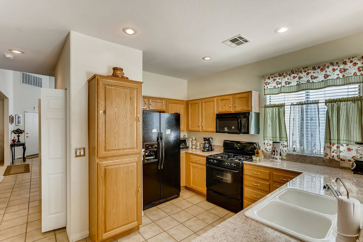 The kitchen at 9137 Dorrell Lane has plenty of storage space. (Virtuance)