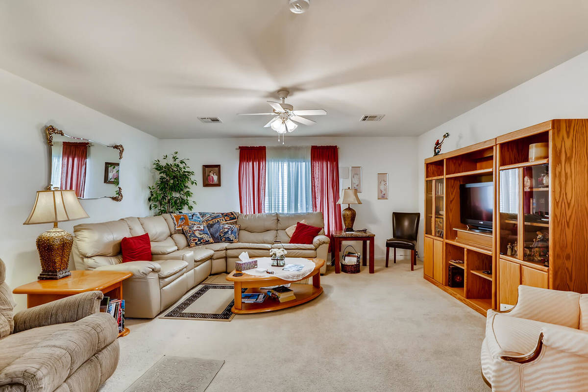 The living room at 9137 Dorrell Lane offers an open, airy feeling. (Virtuance)