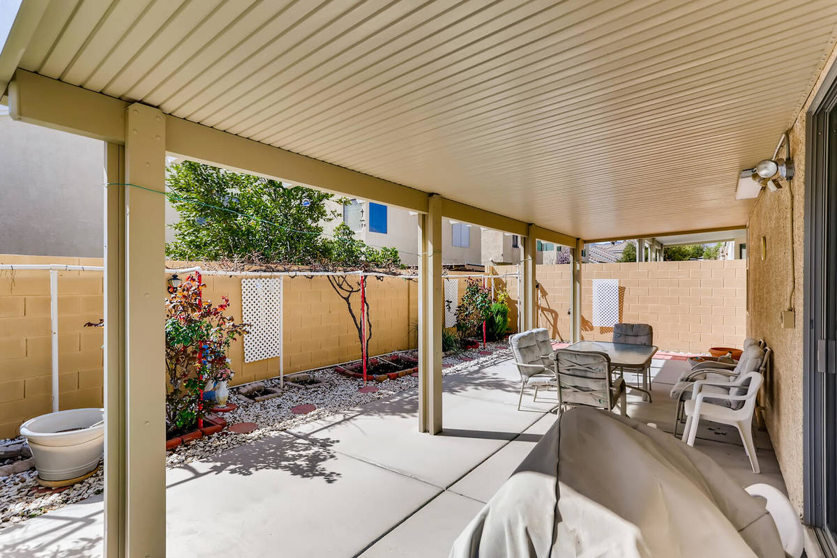 The covered patio at 9137 Dorrell Lane is an entry point for backyard activities. (Virtuance)