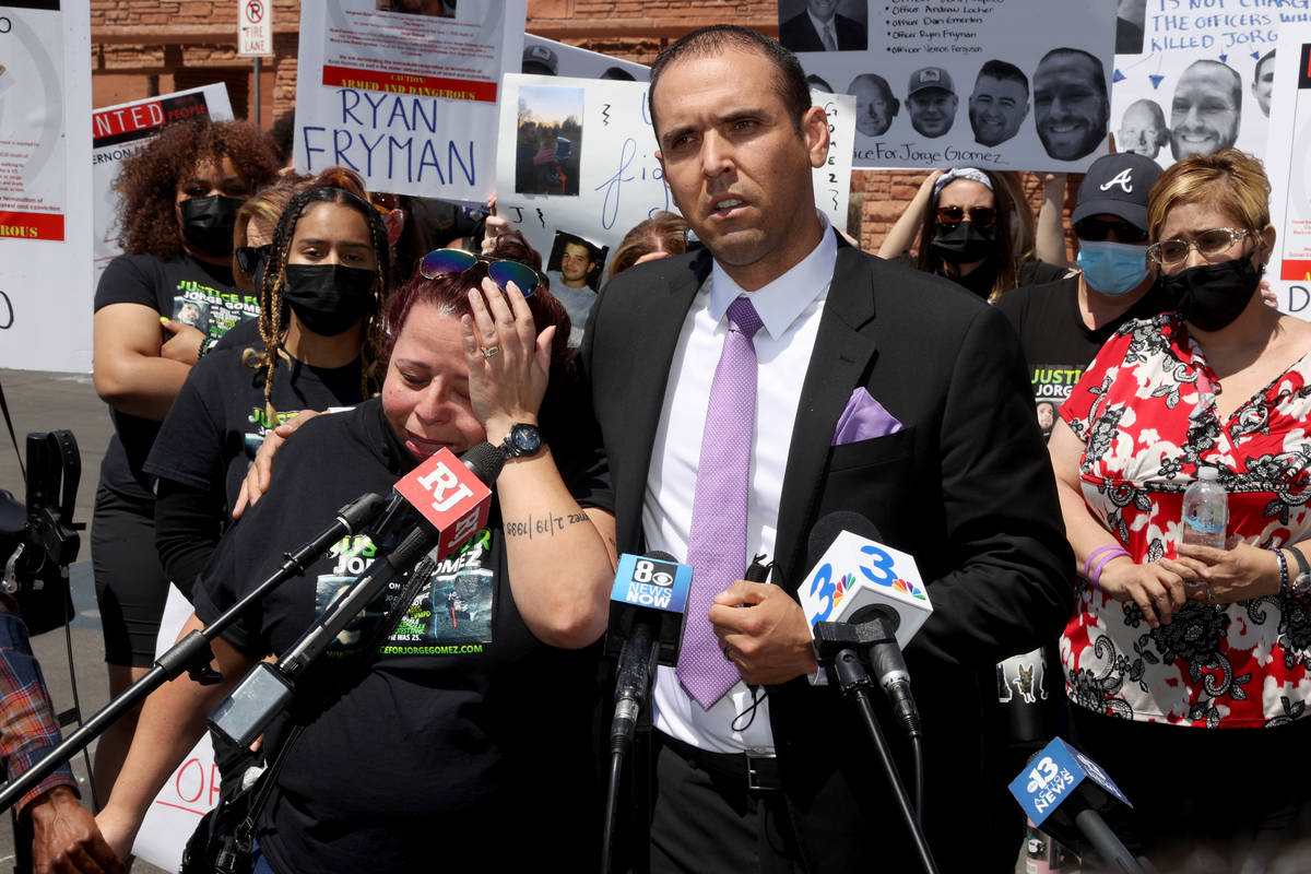 Attorney Rodolfo Gonzalez stands alongside Jeanne Llera, mother of Jorge Gomez, a Black Lives M ...