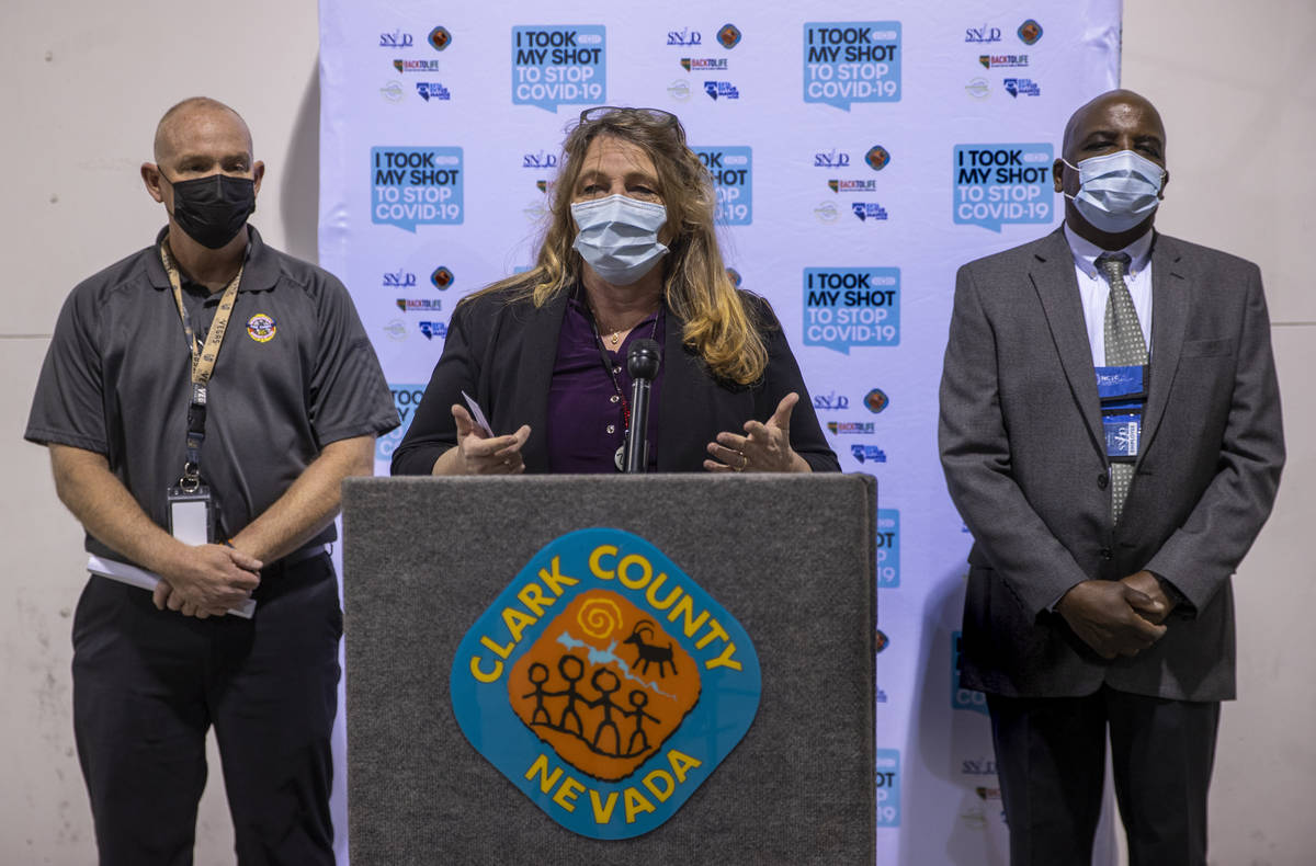 Commissioner Marilyn Kirkpatrick, center, with Chief Greg Cassell, left, and Dr. Fermin Leguen ...