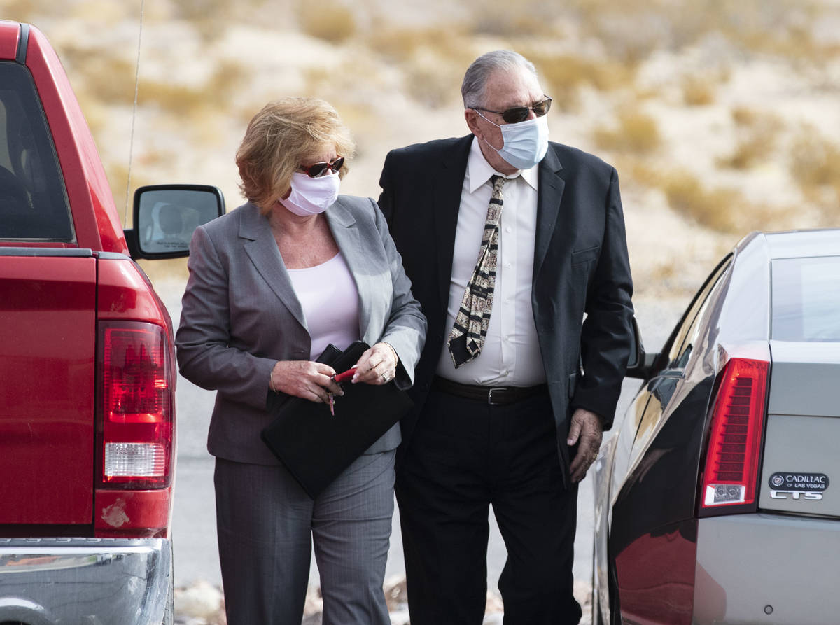 Patricia Chappuis, left, and her husband, Marcel, arrive at Beatty Justice Court for their hear ...