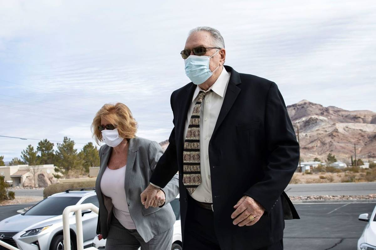 Patricia Chappuis, left, and her husband, Marcel, arrive at Beatty Justice Court on Feb. 1, 202 ...