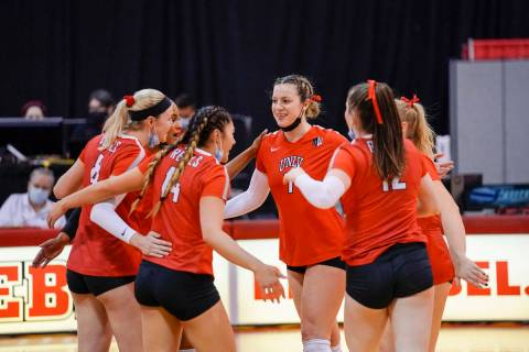 Mountain West Player of the Year Mariena Hayden (center) gathers with UNLV volleyball players a ...