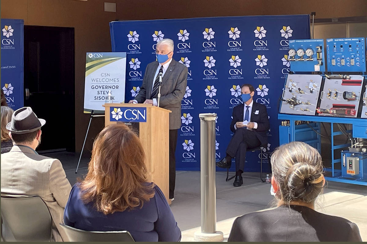 Gov. Steve Sisolak, left, speaks as College of Southern Nevada President Federico Zaragoza watc ...