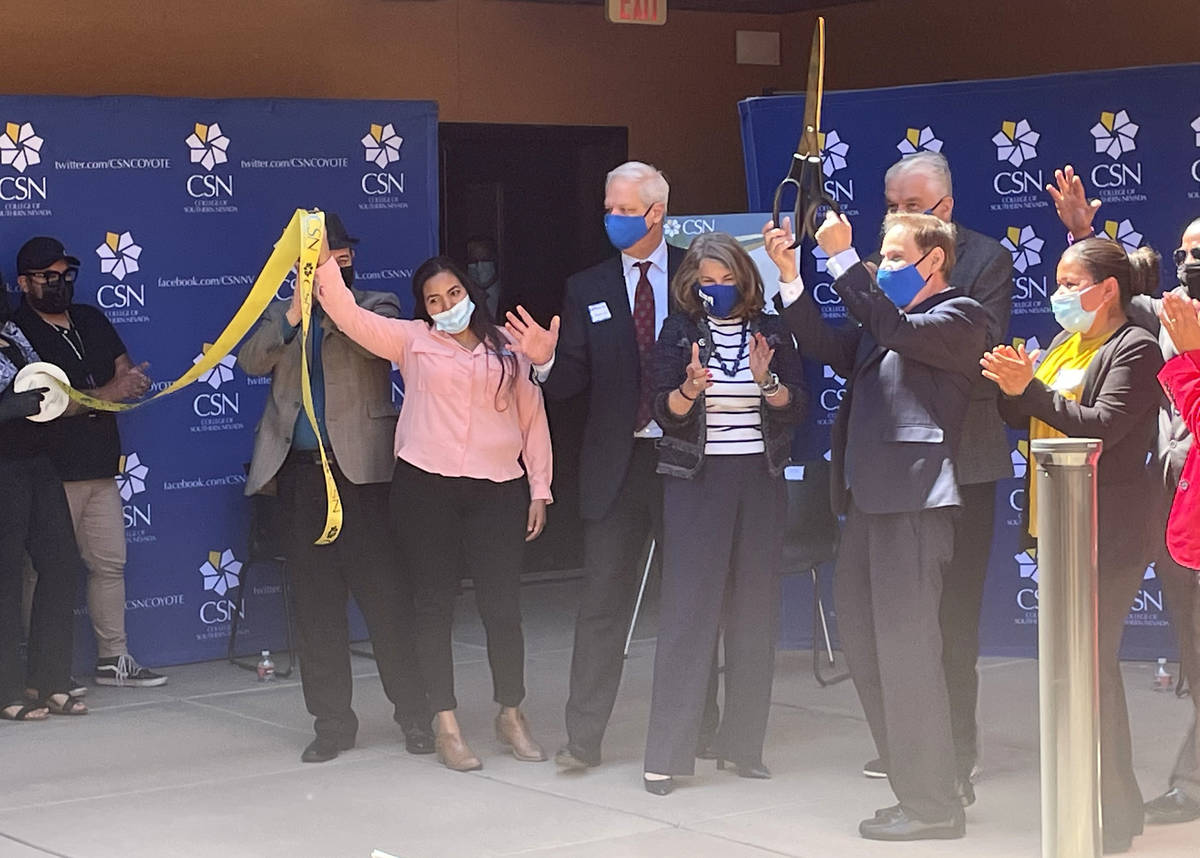 Elected officials and College of Southern Nevada students and employees participate in a ribbon ...