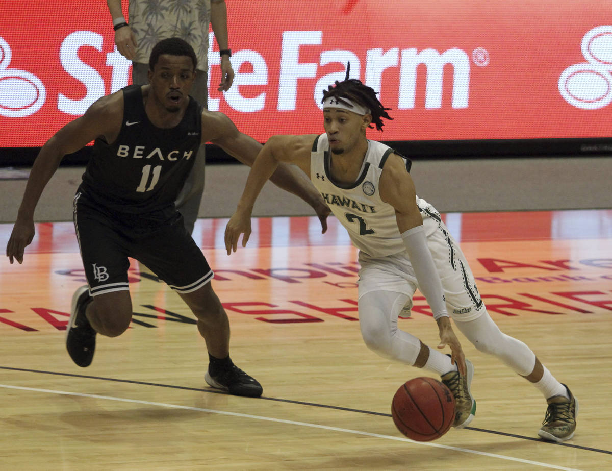 February 26, 2021 - Hawaii Rainbow Warriors guard Justin Webster #2 dribbles past Long Beach St ...