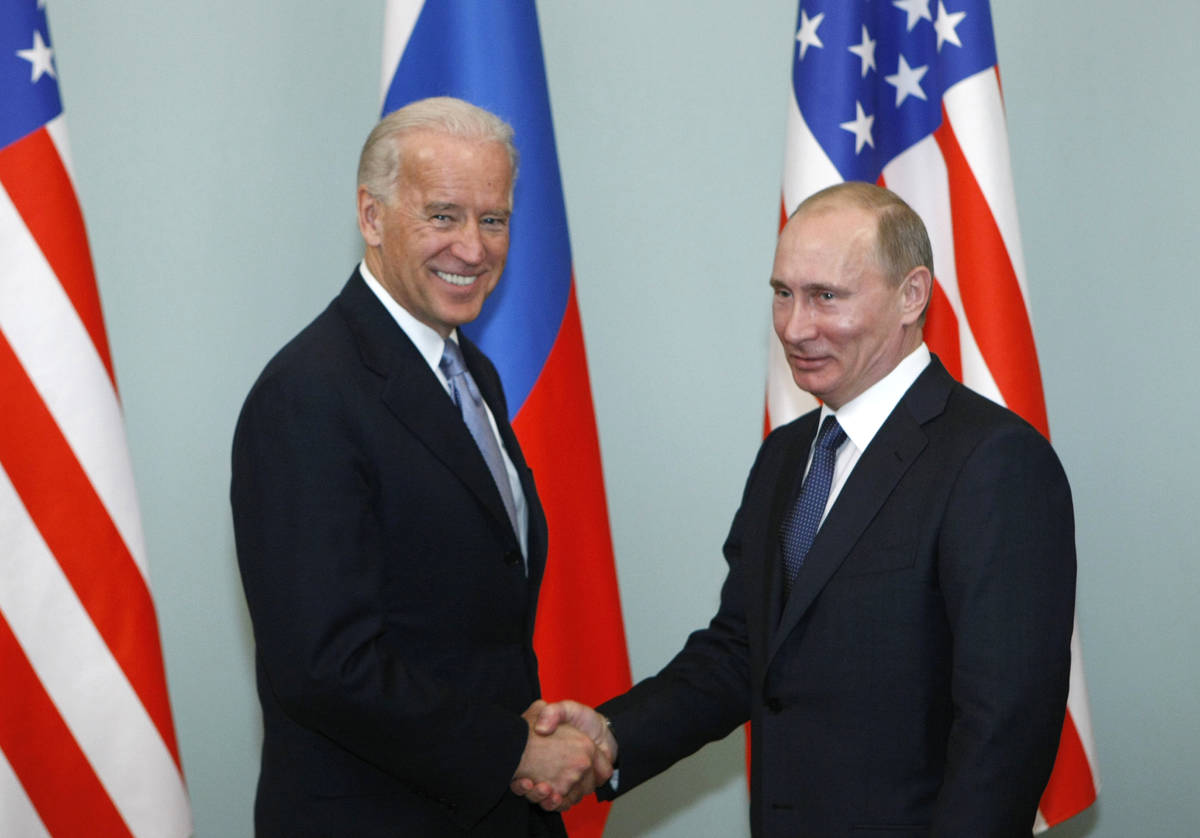 FILE - In this March 10, 2011, file photo, then-Vice President Joe Biden, left, shakes hands wi ...