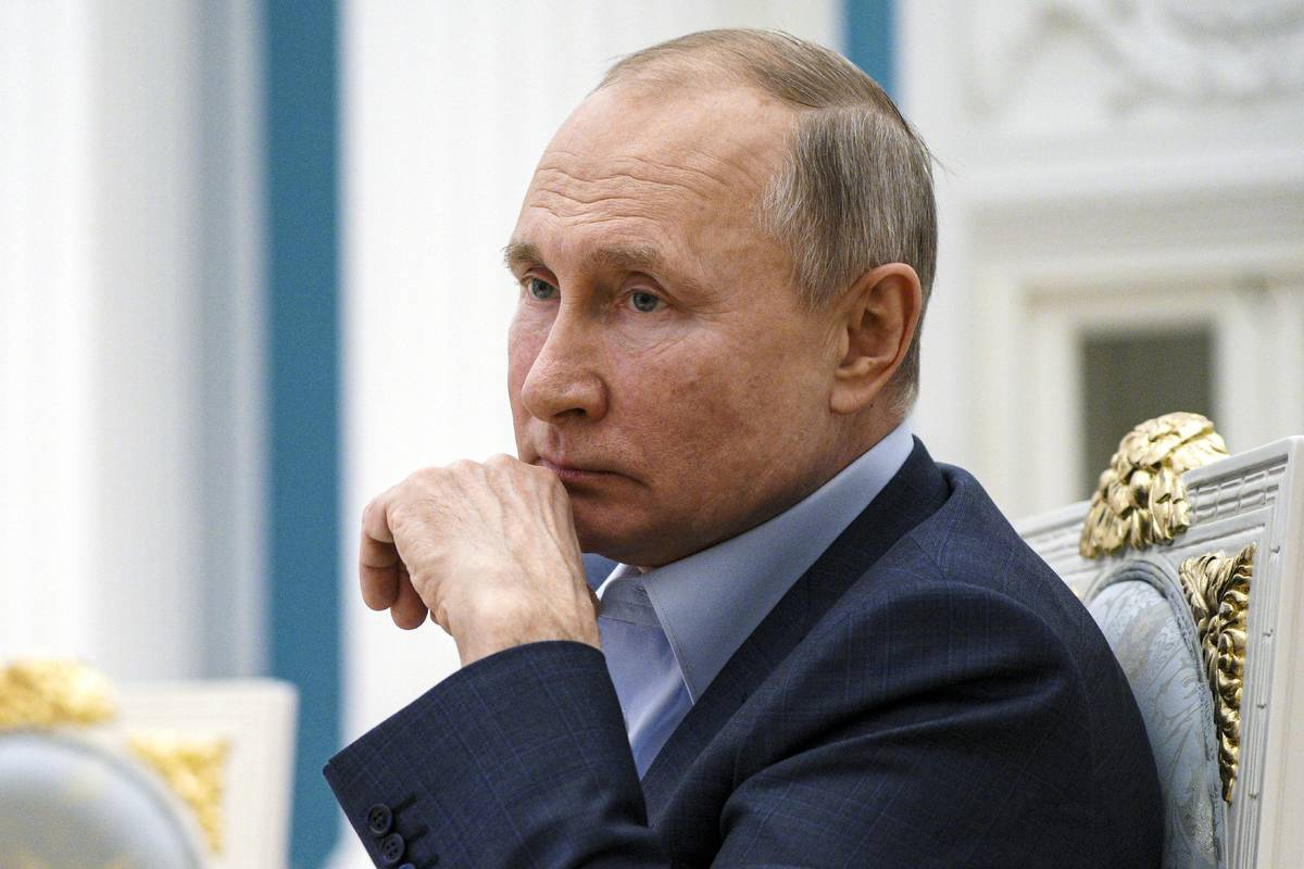 In this Thursday, March 4, 2021, file photo, Russian President Vladimir Putin listens during a ...