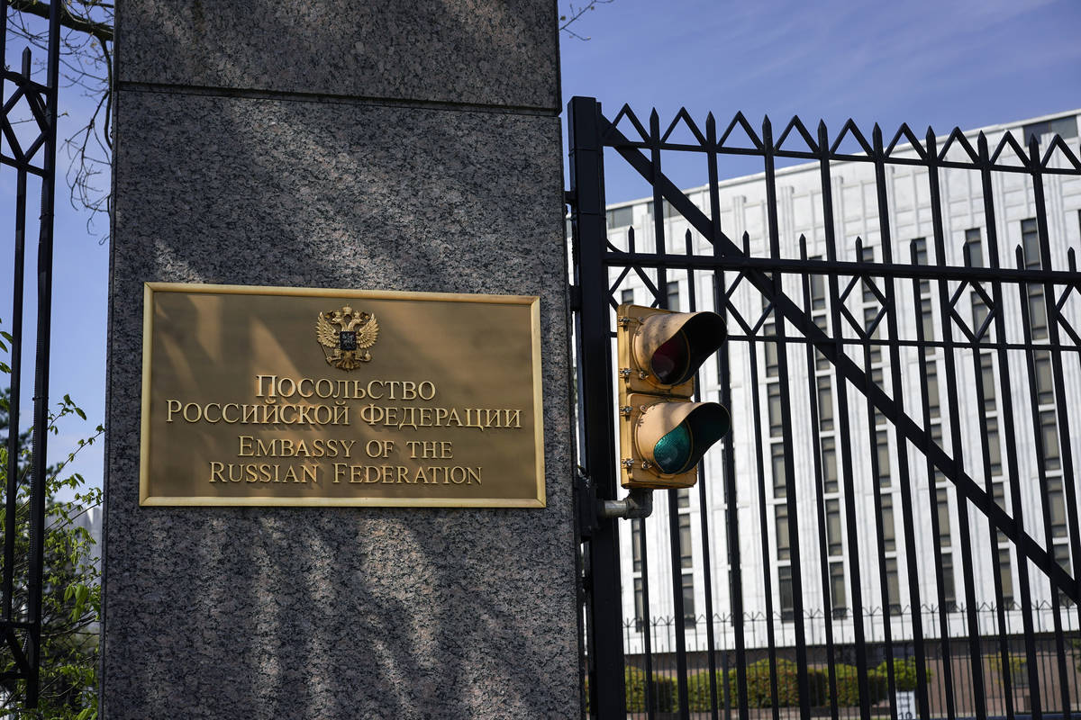 The entrance gate of the Embassy of the Russian Federation is seen in Washington, Thursday, Apr ...