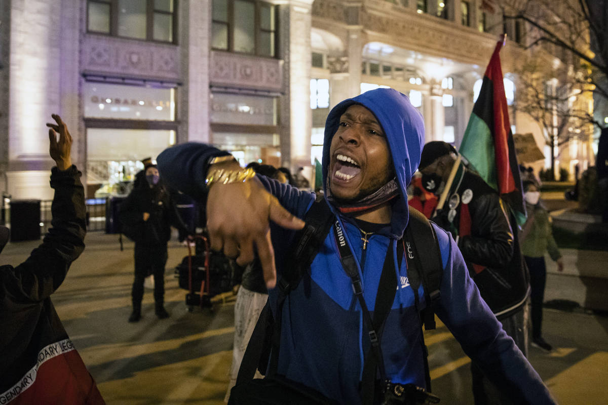 Lamon Reccord leads a chant as dozens of protesters march down the Magnificent Mile after the c ...